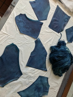Indigo-dyed vellum and wool.